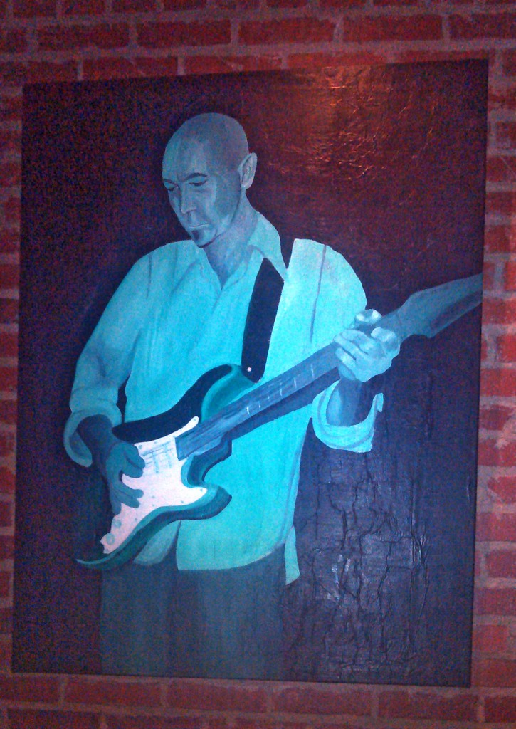 The painting looked like Brian playing Guitar Hero on Wii