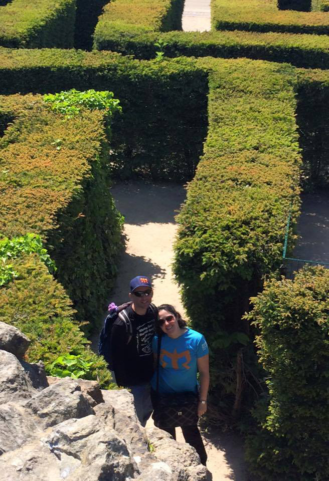 couple in hedge maze near leeds castle
